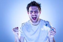 Homem do júbilo com Gamepad Imagem de Stock Royalty Free