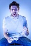 Homem do júbilo com Gamepad Foto de Stock Royalty Free