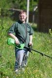 Homem do Lawnmower Imagens de Stock