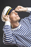 Homem do marinheiro com tampão branco Imagem de Stock Royalty Free