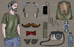 Homem do moderno nos acessórios dos fones de ouvido e do ` s dos homens ajustados Vetor Foto de Stock