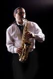 Homem do saxofone imagens de stock royalty free