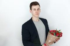 Homem do Valentim com grupo da tulipa, fundo branco Imagens de Stock Royalty Free