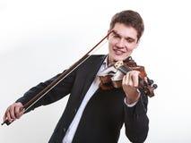 Homem do homem vestido elegantemente jogando o violino imagem de stock