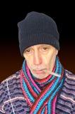 Homem doente no preto Fotos de Stock Royalty Free