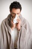 Homem doente que sneezing fotos de stock royalty free