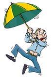 Homem dos desenhos animados com umbrellabeing whisked afastado Fotografia de Stock Royalty Free