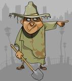 Homem dos desenhos animados na roupa áspera suja com uma pá que aponta no sentido Foto de Stock Royalty Free
