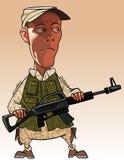 Homem dos desenhos animados que guarda uma arma em suas mãos Fotografia de Stock