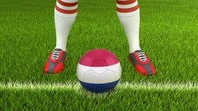 Homem e bola de futebol com bandeira holandesa Foto de Stock Royalty Free