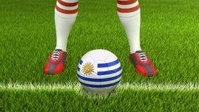 Homem e bola de futebol com bandeira uruguaia Fotos de Stock