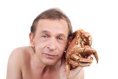 Homem e caranguejo Fotos de Stock