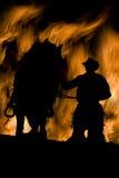 Homem e cavalo nas flamas Fotos de Stock Royalty Free