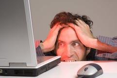 Homem e computador Imagens de Stock