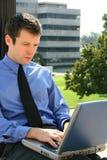 Homem e computador da baixa Fotografia de Stock
