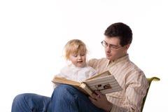 Homem e criança com livro imagens de stock royalty free
