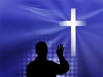 Homem e cruz no fundo azul Foto de Stock