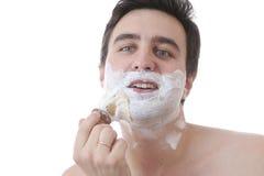 Homem e escova Imagens de Stock