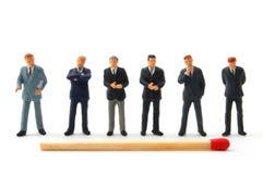 Homem e fósforos de negócio no branco Fotos de Stock Royalty Free