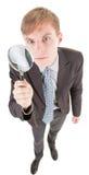 Homem e magnifier Imagens de Stock