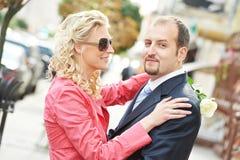 Homem e menina em uma tâmara Imagens de Stock Royalty Free