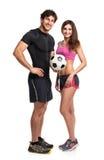 Homem e mulher atléticos com a bola no branco fotos de stock royalty free