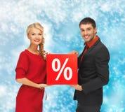 Homem e mulher com sinal de por cento Foto de Stock Royalty Free