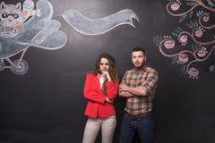 Homem e mulher de negócio no estúdio fotos de stock royalty free