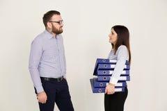 Homem e mulher de negócio nos sócios do trabalho de escritório Imagem de Stock