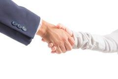 Homem e mulher de negócio que agitam a mão imagem de stock