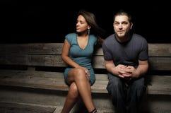 Homem e mulher em um banco Fotos de Stock Royalty Free