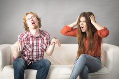 Homem e mulher que têm a luta imagem de stock