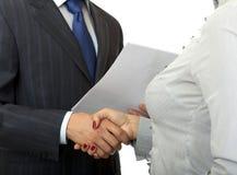 Homem e mulheres do aperto de mão. Imagem de Stock
