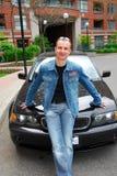 Homem e seu carro Imagens de Stock