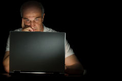 Homem e seu portátil Foto de Stock
