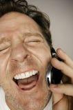 Homem ectàtica feliz no telefone de pilha Foto de Stock Royalty Free