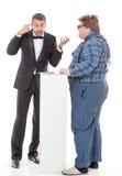 Homem elegante que discute com uma caipira do país Imagens de Stock Royalty Free