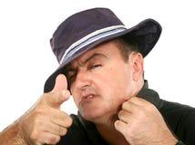 Homem em apontar do chapéu fotografia de stock royalty free