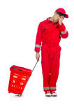 Homem em combinações vermelhas com o carro do supermercado da compra Fotografia de Stock