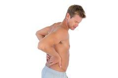Homem em topless que sofre da dor nas costas Fotografia de Stock