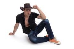 Homem em um chapéu de vaqueiro Imagens de Stock Royalty Free