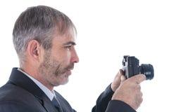 Um homem com uma câmera Foto de Stock Royalty Free