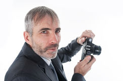 Um homem com uma câmera imagens de stock royalty free