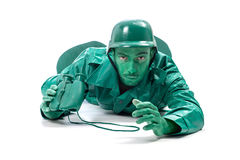 Homem em um traje verde do soldado de brinquedo Imagem de Stock