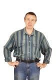 Homem em um vestido da sarja de Nimes Fotos de Stock Royalty Free
