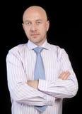 Homem em uma camisa listrada e em um laço Imagens de Stock Royalty Free