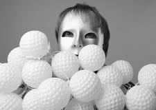 Homem em uma máscara de prata com uma polia das cápsulas do nock Foto de Stock Royalty Free