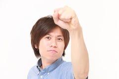 Homem em uma pose da vitória Imagens de Stock Royalty Free