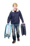 Homem engraçado com bagagem Fotos de Stock Royalty Free