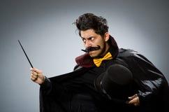 Homem engraçado do mágico com varinha Fotografia de Stock Royalty Free